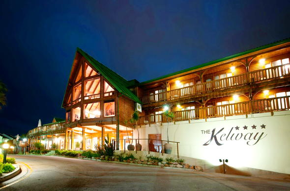 Exterior view of Kelway Hotel by night.