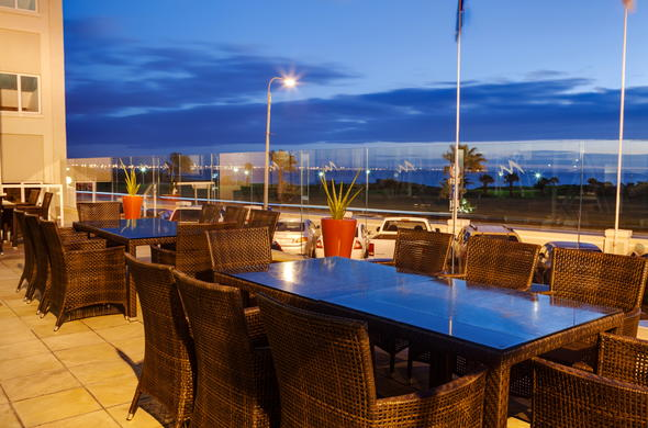 Dine on the Protea Hotel Marine deck with stunning sea views.